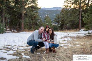 Littleton family photographer child kid daughter snow winter Mt. Falcon golden hour sunset natural light photography