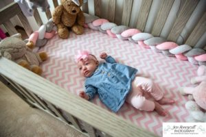 Littleton baby photographer family in home lifestyle newborn three month old girl sister sisters winter Christmas December sweet natural light photography crib nursery
