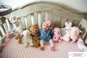 Littleton baby photographer family in home lifestyle newborn three month old girl sister sisters winter Christmas December sweet natural light photography crib crying sad stuffed animals nursery
