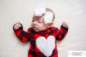 Littleton baby photographer family in home lifestyle newborn three month old girl sister sisters winter Christmas December sweet natural light photography sleeping sleepy sleeper
