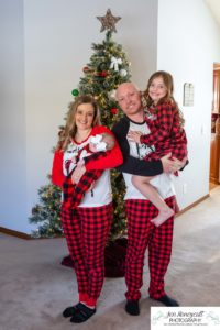 Littleton baby photographer family in home lifestyle newborn three month old girl sister sisters winter Christmas December sweet natural light photography