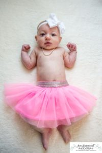 Littleton baby photographer family in home lifestyle newborn three month old girl sister sisters winter Christmas December sweet natural light photography tutu pink