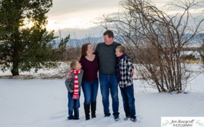 The {R} family of 4 in the snow at the Highlands Ranch Mansion by Littleton photographer