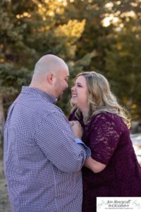 Littleton engagement photographer Mt. Falcon in love husband wife engaged mr. and mrs. mountains Colorado April wedding future marriage married diamond ring photography sunset fun laughter