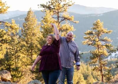 Littleton engagement photographer Mt. Falcon in love husband wife engaged mr. and mrs. mountains Colorado April wedding future marriage married diamond ring photography sunset twirl dancing