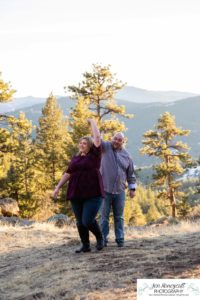 Littleton engagement photographer Mt. Falcon in love husband wife engaged mr. and mrs. mountains Colorado April wedding future marriage married diamond ring photography sunset twirl dance