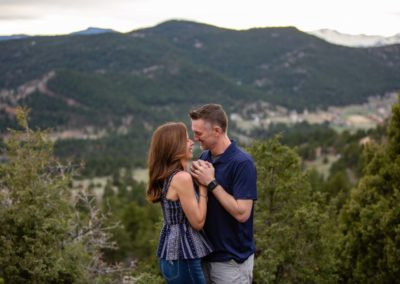 Littleton family photographer couple in love married marriage Mt. Falcon park Colorado mountains husband and wife sunset photo session