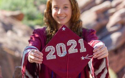 Kate's cap and gown graduation mini session at Red Rocks by Littleton high school senior photographer